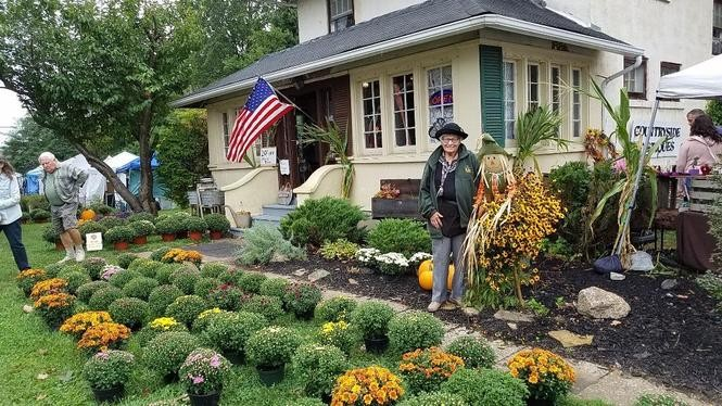 Lois Shinko, long-time owner of Countryside Antiques and Collectibles, posed in her favorite hat for Fall Into Avon.