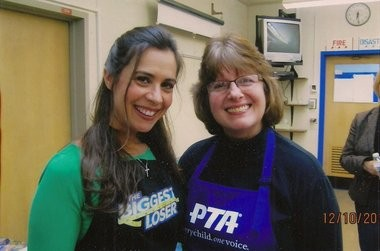 """Biggest Loser"" chef Devin Alexander stands to the left of Bay Village PTA President Pam Bonnett at Bay High School."