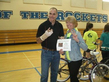 Chris Speyer, chief operating officer of Accell North America, the parent company of Raleigh Bicycles, presents Bay Village Mayor Deborah Sutherland with a check and a Bike-to-School award. Originally, the check was to be for $1,000, but the company decided to double its donation to $2,000.