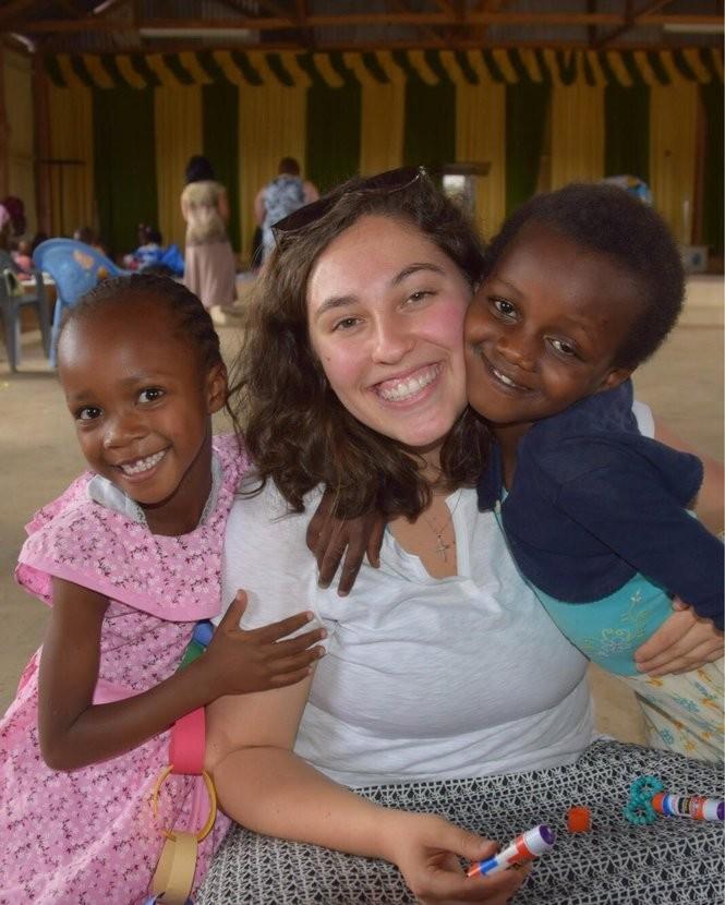 Katie Koomar and Kenyan girls. Photo courtesy of Carolyn Rose.