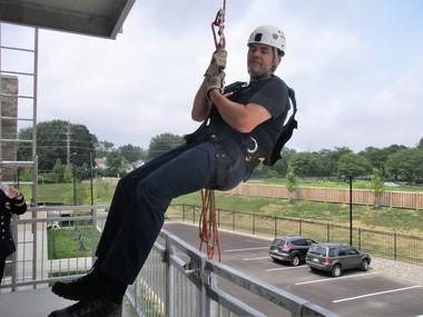 There are many opportunities for firefighters to train at the new Public Safety Center. Here, Beachwood firefighter Don Balog rappels on a rear wall of the building.