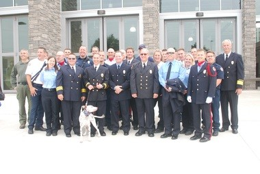 Beachwood's fire-rescue workers pose Sunday in front of the new Public Safety Center.