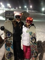 Snowboarders Kaitlyn, 12, and Karli Kovac, 10, of Brecksville, are easy to spot wearing their dad's invention called Lid Lights®.