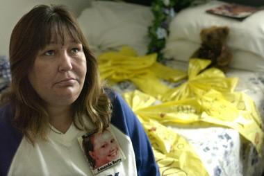 "Louwana Miller sits on her daughter Amanda ""Mandy"" Berry's bed in September 2003."