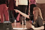 Kim Cipriani directs cast of ANNIE during practice