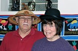 Phil and Carolyn Dale, donning hats from Burkina Faso and Bolivia