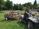 A scoutmaster and his son used an ATV to bring up the bigger pieces of debris.