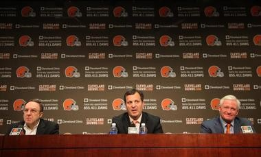Mike Lombardi, center, newly appointed vice president-player personnel for the Cleveland Browns, holds introductory press conference at club's training facility in Berea on Friday, Jan. 18, 2012. At left is Joe Banner, Browns' CEO, and at right team owner Jimmy Haslam.