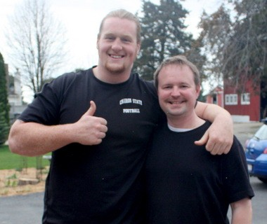 """Garrett Gilkey with his pastor, Charlie Grenade, whom he credits for helping him deal with the bullying issues of his youth and the temptation of steroids as a potential NFL prospect. """"We tried to encourage him not to let his value get wrapped up (just in football),"""" Grenade said."""