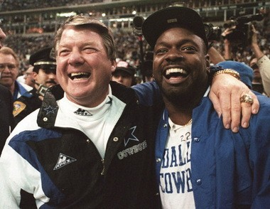 Dallas Cowboys head coach Jimmy Johnson, left, and running back Emmitt Smith celebrate in the final moments of their 38-21 NFC Championship win over San Francisco on Jan. 23, 1994 in Irving, Texas. Johnson earned respect from players for the attacking mentality he brought to coaching, and that has rubbed off on three men who are now at the key positions on the Browns staff.