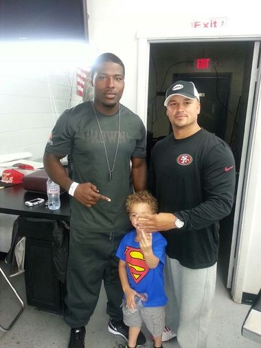 Browns running back Glenn Winston, left, with Jeffrey Johnson and Johnson's son.