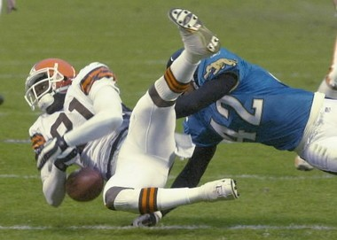 Morgan (81) has the ball slip out of his arms as he is hit by Jacksonville's Boyd.