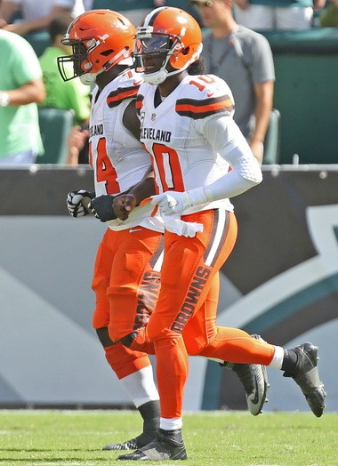 Robert Griffin III walks off the field with Cameron Erving after Erving made a high snap for a safety.