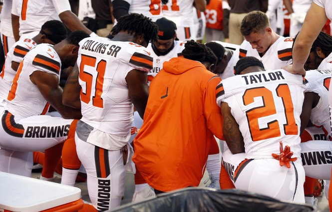 Members of the Cleveland Browns kneel during the national anthem on Monday night prior to their game against the Giants.