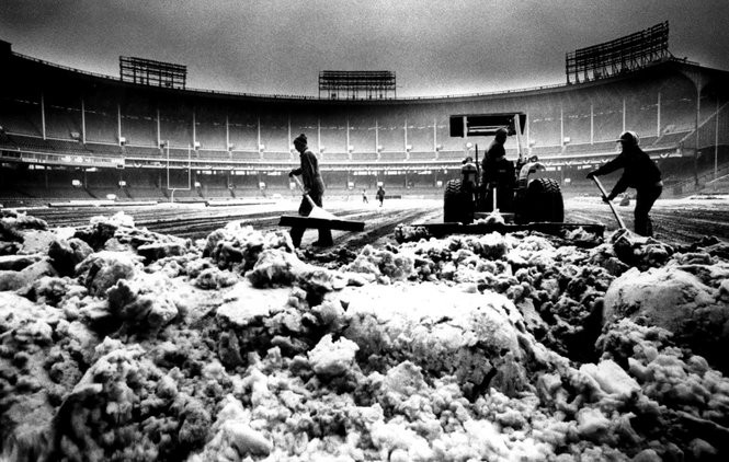 Snow is cleared from Cleveland Stadium before the 1986 playoff game on Jan. 3, 1987.