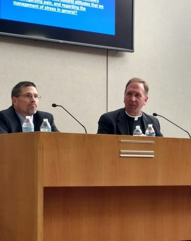 Phillip Titterington, executive director, Medina County ADAMH Board and co-chair of the Medina County Opiate Task Force (left) and Fr. Bob Stec, pastor of St. Ambrose Church, were part of a June 21 panel in Brunswick discussing a growing opioid epidemic in the community.