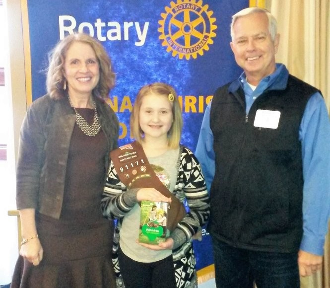 Susan Vlcek with Girl Scout Ava Kanieski of Troop 91171 and Rotary President Roger Hassler discussed Girl Scout cookies and the Junior Leadership's upcoming program.