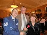 William and Kathy Koran celebrate Wine & Roses with TSgt Adam Zelenka of the Akron Honor Guard Team.