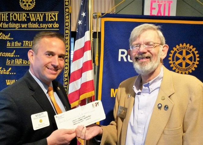 Rotary Armed Forces Award Veterans. Scott Bradley (US Navy Seabee), left, presents Rotary donation for VA Veterans to Jack Young (US Air Force).