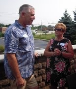 Tom Rounds was having a serious discussion with Connie Eskesen.