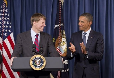 President Barack Obama visited the new director of the Consumer Financial Protection Bureau, Richard Cordray, left, at CFPB's offices in Washington in January 2012 after recess-appointing him. (AP Photo/J. Scott Applewhite)