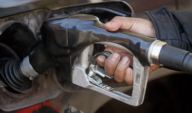 Gasoline prices are expected to slowly fall over the next year while U.S. oil production climbs monthly and is on track to reach 1972 levels this year and approach peak 1970 levels in 2015, says the U.S. EIA.