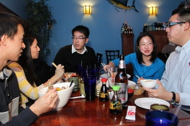 From left, Roger Lin, Fung-Lin Wu, C.C. Chen, Rachael Ng and Benjamin Shyong talk about life in Cleveland at one of their favorite restaurants, Pacific East on Coventry Road.