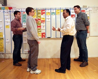 Anil Jain, second from right, leads one of the stand-up meetings that occur frequently at Explorys, a Cleveland startup pioneering Big Data in the health care realm. Jain invented its early technology and helped assemble a staff that includes, from left, product manager Mark Modic, software engineer Scott Sosnowski, and director of infomatics Jason Gilder.