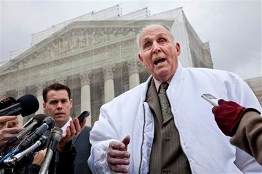 Vernon Hugh Bowman, a 75-year-old Indiana soybean farmer, accompanied by his attorney Mark Walters, speaks with reporters outside the Supreme Court in Washington, Tuesday.