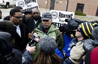 Sam Riddle, political director for the National Action Network speaks outside Hurley Medical Center Tuesday, Feb. 19 in support of nurses who claim the hospital honored a father's request that no black nurses care for his child.