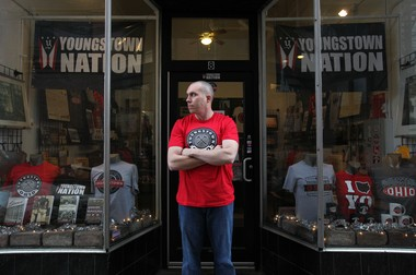 """From his downtown shop, Phil Kidd promotes his """"Defend Youngstown"""" approach to community building. The philosophy generated smiles during hard times and added momentum to the city's comeback."""