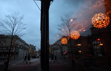 Lights glow inside the V2 Wine Bar Trattoria, one of several new bright spots in downtown Youngstown.