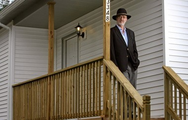 Robert Klein, the founder and chairman of Safeguard Properties, stands in front of a house in Cleveland in 2009. Klein was Safeguard's chief executive until 2010 and frequently talks about the need to fast-track the foreclosure process and eliminate the blight of empty homes in neighborhoods. Now the state of Illinois has sued Safeguard over the company's handling of homes wending their way through the delinquency process or foreclosure.