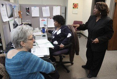 Carolyn Berry (right) and Clarice Jones (center) participate in the AARP Foundation Senior Community Service Employment Program, where they receive training to help other unemployed older workers find jobs. Here they help complete paperwork for Norma Wise of Cleveland, who has not had a full-time job since 2007. Older workers suffer from long-term unemployment more than any other age group. A
