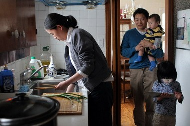 Proponents of immigration reform say it could bring more couples like Qiao and Ranjun Bao to the region. Qiao, left, a cancer researcher for the Cleveland Clinic, and Ranjun, an entrepreneur, immigrated from China. They were photographed in 2011 in the home they had recently bought in University Heights. Daughter Deja was then 4 and David 11 months.