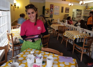 Julie Caruso, clearing a table at Valley Cafe in Akron, said she feels fortunate to work for a small business owner who pays more than both the federal $2.13 an hour minimum wage for tipped workers and Ohio's minimum of $3.93 an hour. At 24, Caruso lives at home nearly two years after earning a political science degree, but she plans to start a new job soon in her chosen field.