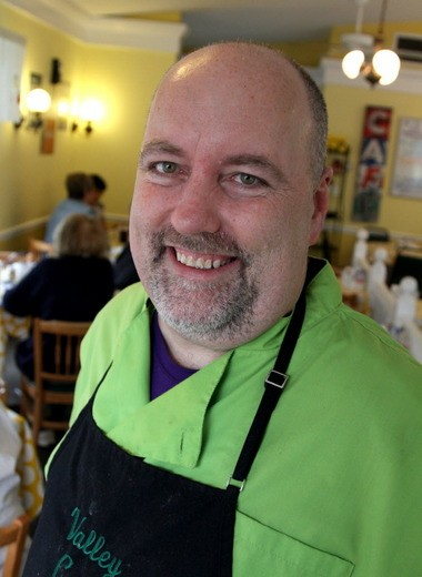 """B.J. Mikoda, owner of Valley Cafe in Akron said he pays a minimum of $5.50 per hour to tipped servers to compensate for their hard work and sometimes less than adequate tips from customers. While analysts, economists, politicians and business owners debate whether the federal minimum wage should be raised from $7.25 to $10.10 an hour by 2015, and whether the federal minimum for tipped workers should be raised from $2.13 an hour, Mikoda said he believes business owners should focus on the golden rule: """"AAIf you take care of people it'AAs going to come back to you."""""""