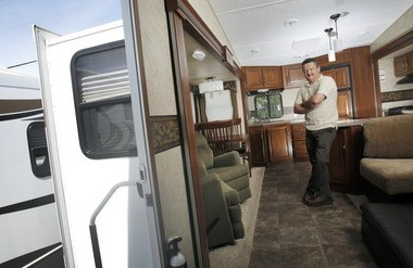 """Manuel Santiago, managing partner at Moore's RV in North Ridgeville, said RV sales are up dramatically from three years ago and even up from last year. """"Americans love camping,"""" he said."""