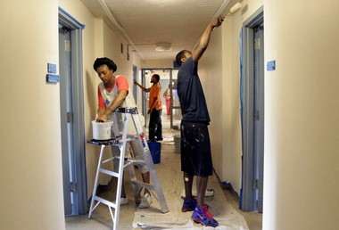 Among the 24 men and women learning professional painting techniques in the HomeWork program are, from left, Modesty Henderson, Juan Cedeno and Ryan Fowlkes.