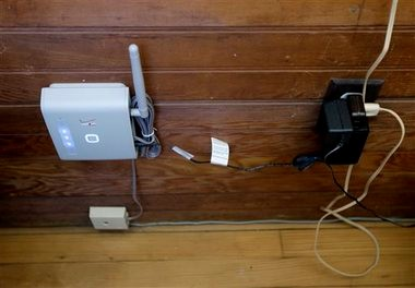 a wireless device that can be connected to a home phone for service is seen  inside
