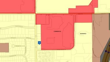 A zoning map shows the current land use classifications in Beachwood at the intersection of Richmond and Cedar roads.