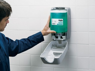 GOJO Industries of Akron says sealed soap dispensers like this one, where the soap is sealed into a bag or cartridge at the factory and never opened in the bathroom, are safer and less prone to contamination by harmful bacteria than refillable soap dispensers.