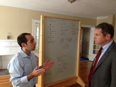 LaunchHouse co-founder Todd Goldstein (left) explains the new fiber Internet connection to Senator Sherrod Brown, who visited one of the LaunchHouse entrepreneur homes on Monday.
