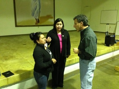 Nora Galvez-Rolero talks with Veronica Dahlberg, the director of HOLA Ohio, and Rev. William Thaden, pastor of Sacred Heart Chapel, at a gathering at the Lorain church November 4, 2013.