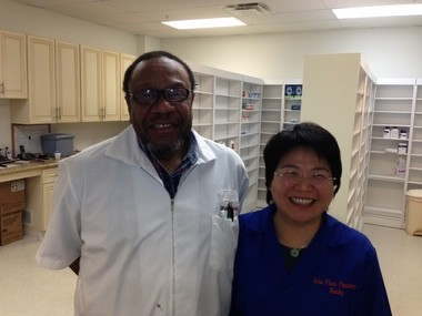 Hui Wang of Westlake, right, and Horace Simmons of Warrensville Heights opened the first multi-lingual pharmacy in the Asian immigrant community.