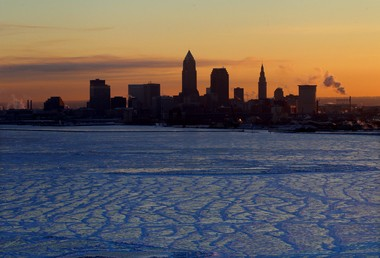 The invasion of arctic air has frozen over much of Lake Erie in this frigid scene of Cleveland's skyline from Lakewood earlier this week.