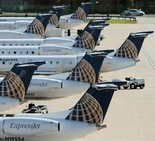 Continental Express jets line the gates at Terminal D at Cleveland Hopkins International Airport in this 2010 file photo. Aviation experts say the high cost of flying 50-seat regional jets likely contributed to United's losses at the airport.