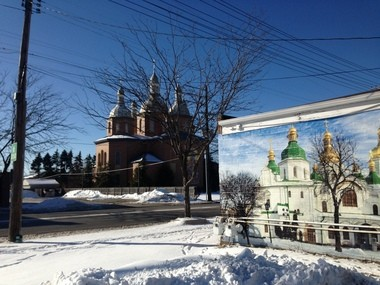 St. Josaphat Ukrainian Catholic Cathedral warms a stretch of State Road in Parma, where murals adorn Ukrainian businesses.