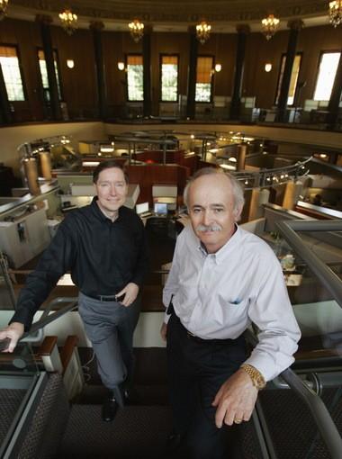 John Nottingham, left, and partner John Spirk posed above their design floor in a former church sanctuary in 2007.