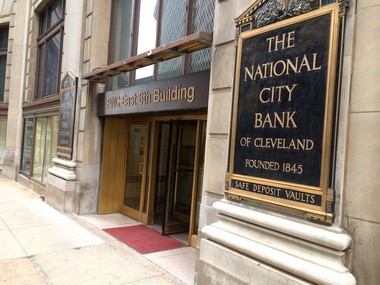 Historic National City Bank signs adorn the East Sixth Street entrance to the Garfield Building. Peter Ketter of Sandvick Architects, which is working on the project with Millennia, said the building originally housed the Cleveland Trust Co. but was home to National City starting in 1921.